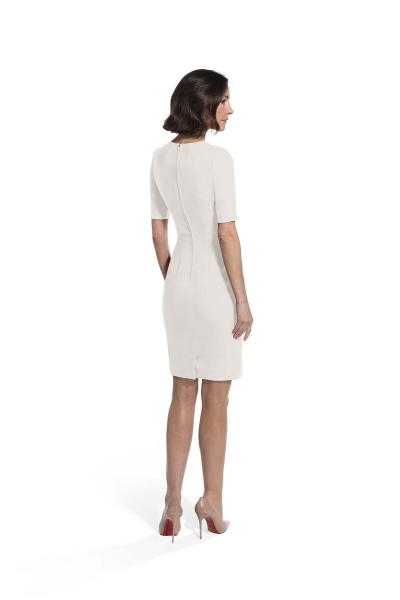 back view of woman 1 wearing the ivory alpha dress Ivory Collection hover