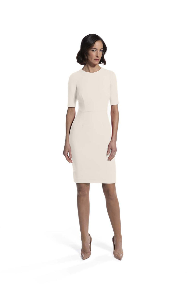 front view of woman 1 wearing the ivory alpha dress ivory collection