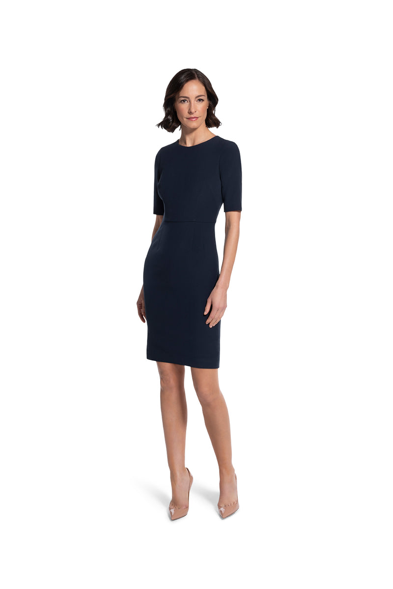 front view of woman 1 wearing the navy alpha dress not your average navy collection