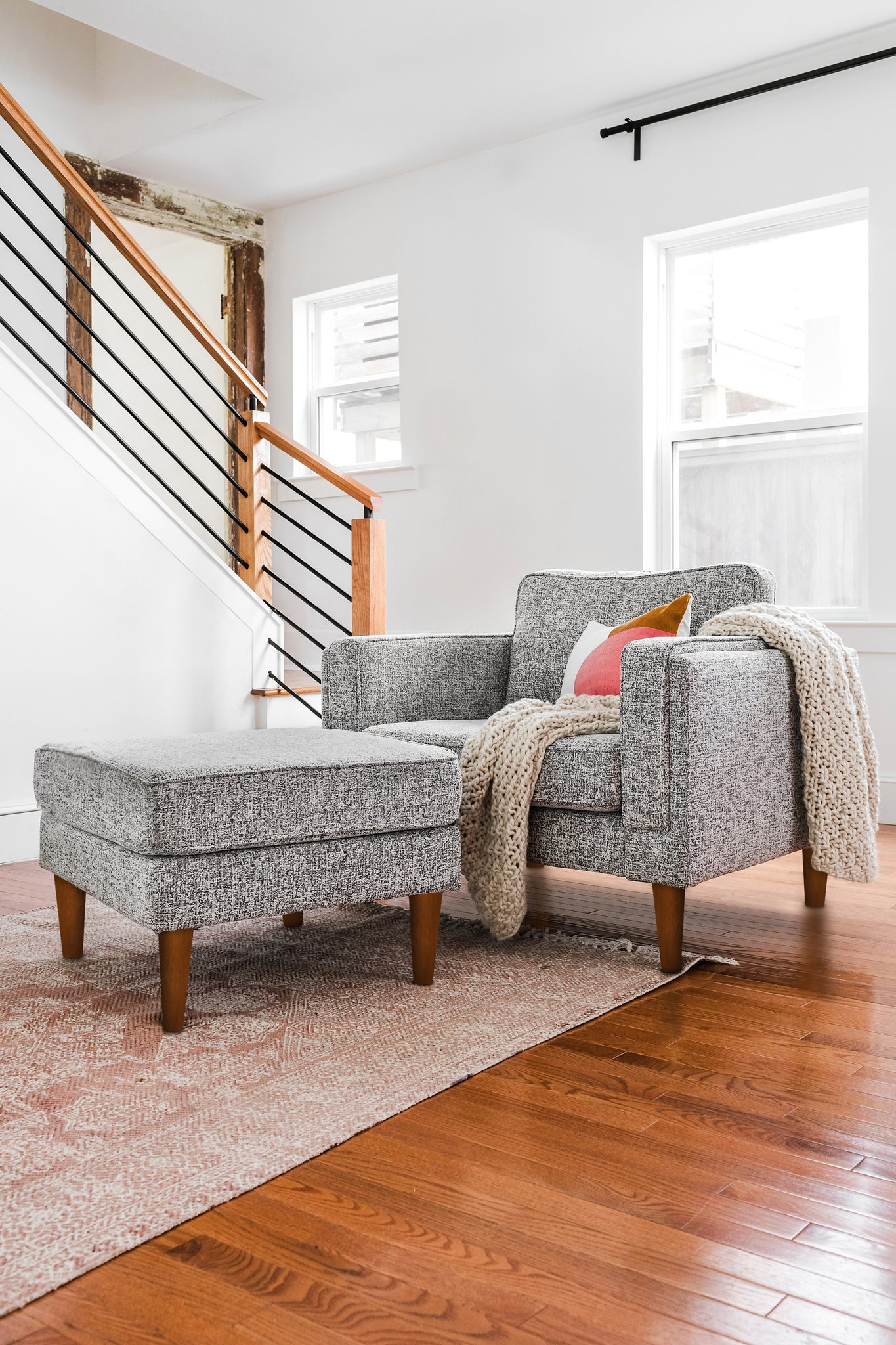 grey fabric armchair with walnut legs albany park