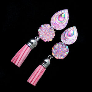Cotton candy pink iridescent teardrop earrings with suede tassle. Push back fastening.