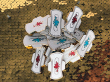 "Load image into Gallery viewer, 1.75"" Menstrual Pad Enamel Pin - Blue or Red Glitter"