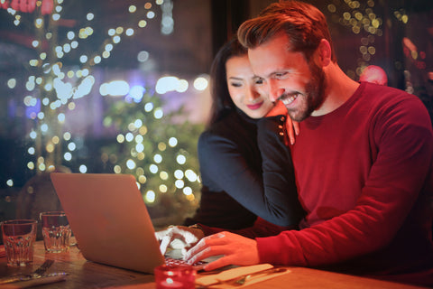 couple looking at laptop booking wedding suppliers
