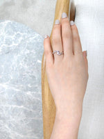solitaire_diamond_twist_engagement_ring_white_gold_MODEL_HAND