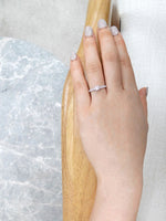 classic_diamond_engagement_ring_white_gold_on_model_hand