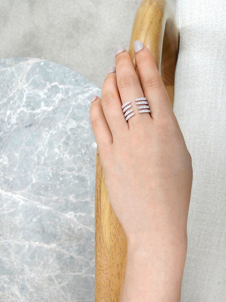 four_rows_diamond_big_ring_white_gold_on_model_hand