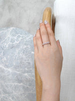 thin_marquise_diamond_wedding_ring_rose_gold_on_hand
