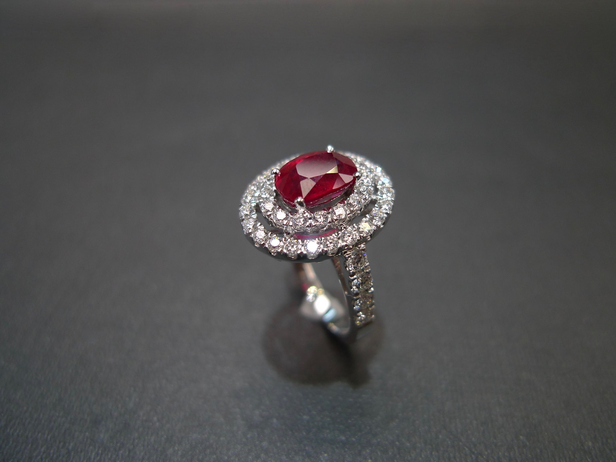 double_halo_diamond_burma_oval_cut_ruby_ring_white_gold