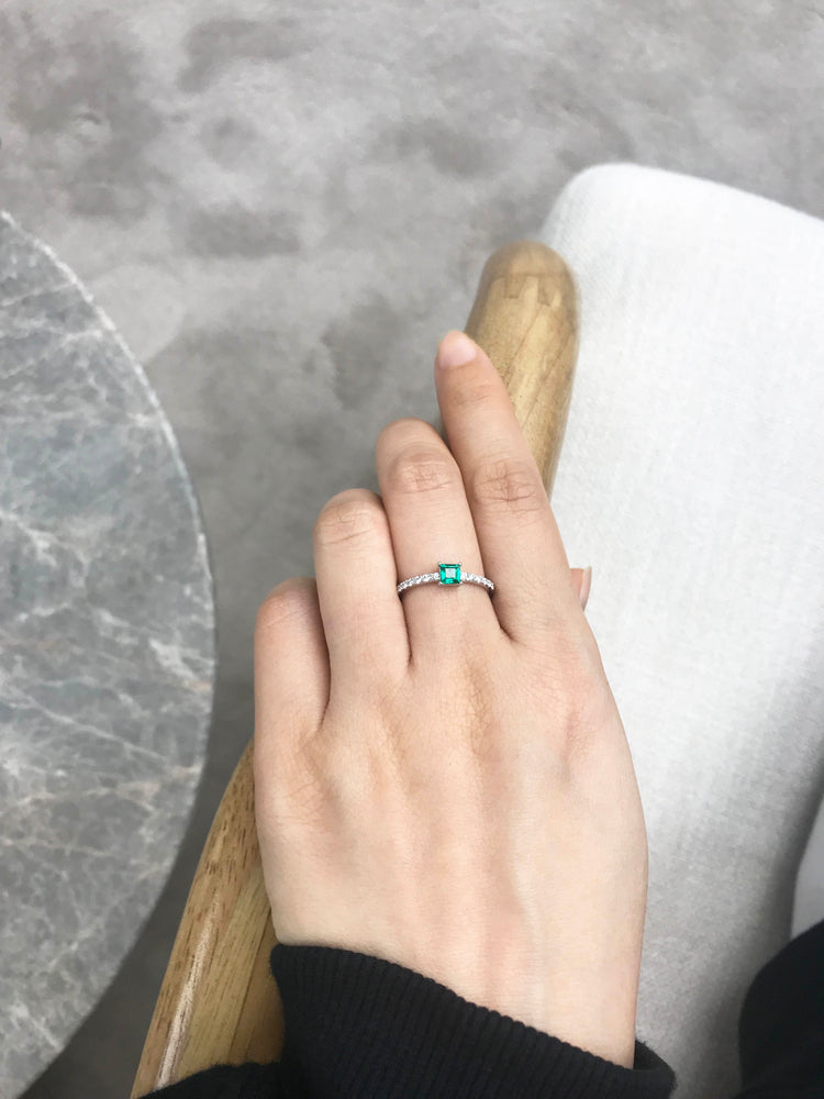 square_cut_emerald_diamond_engagement_ring_white_gold_on_model_hand