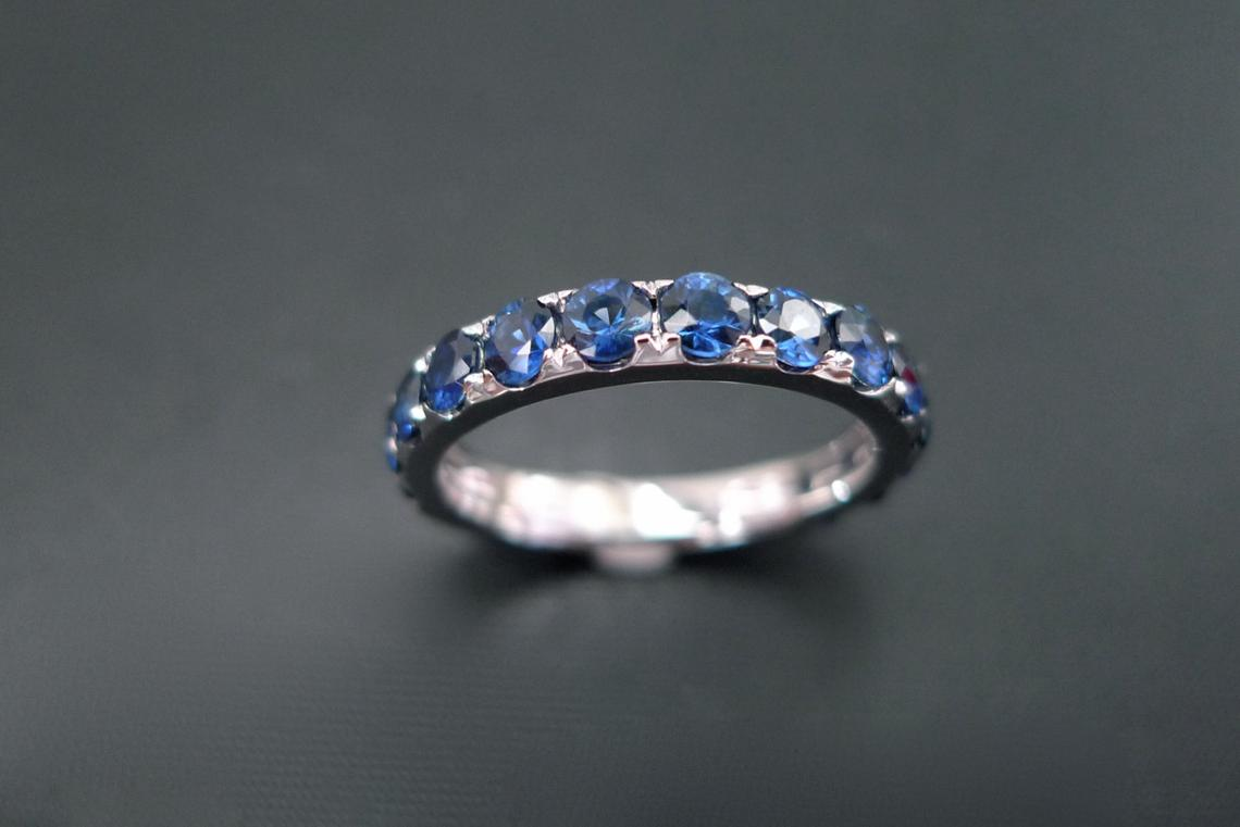 blue_sapphire_half_eternity_wedding_ring
