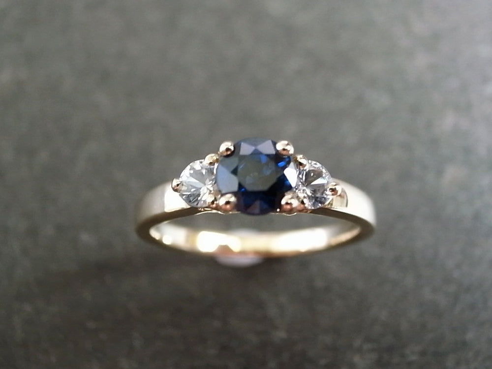 three_stone_blue_sapphire_engagement_ring_yellow_gold