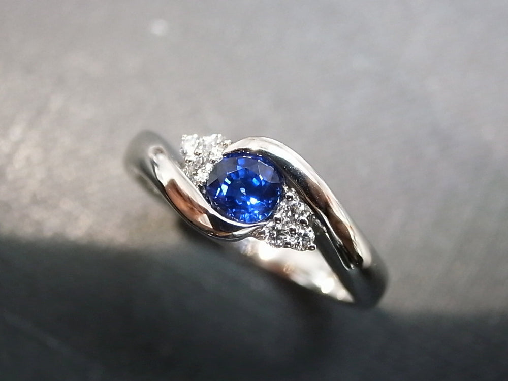 blue sapphire and diamond twist ring