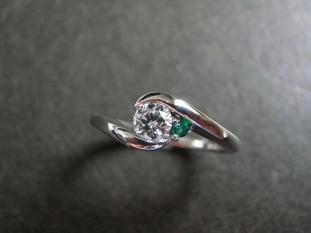 Emerald & 0.25ct Diamond Engagement Ring