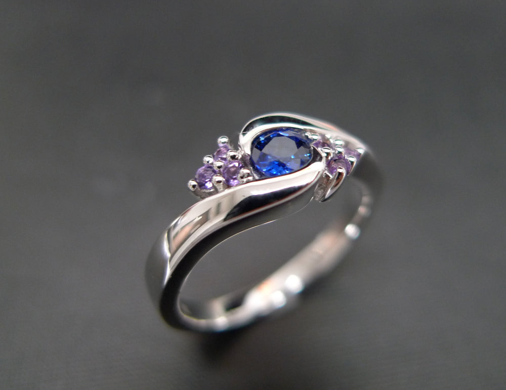 blue_sapphire_amethyst_twist_engagement_ring_white_gold