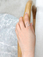 mini_v_shape_diamond_wedding_ring_white_gold_on_model_hand