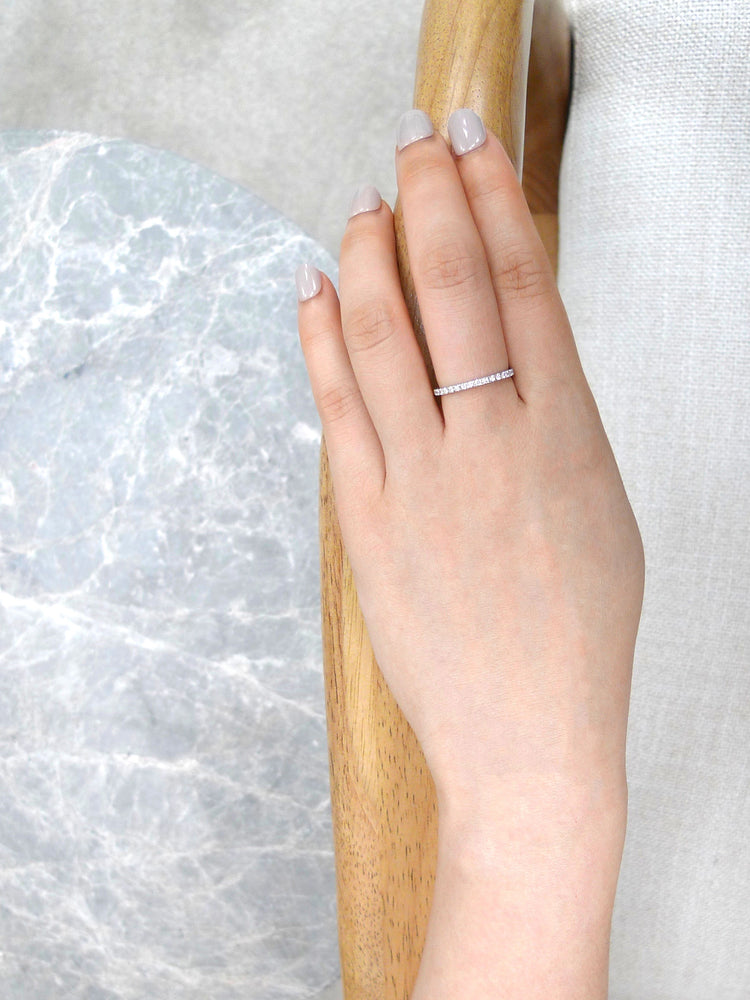 thin_diamond_wedding_ring_white_gold_on_model_hand