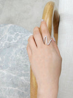 v_shape_diamond_wedding_ring_on_model_hand