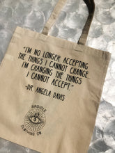 "Load image into Gallery viewer, ""I am no longer accepting the things I cannot change.  I am changing the things I cannot accept."" -Dr. Angela Davis  This RCC original hand rendered ink drawing adorns one side of this saucy lil tote, while the encouraging and invigorating words of Dr. Angela Davis bring life to the other side."
