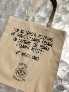 """I am no longer accepting the things I cannot change.  I am changing the things I cannot accept."" -Dr. Angela Davis  This RCC original hand rendered ink drawing adorns one side of this saucy lil tote, while the encouraging and invigorating words of Dr. Angela Davis bring life to the other side."