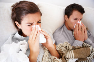 couple fighting allergies in bed needs hypoallergenic bedding