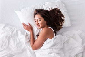 Woman sleeping blissfully with the best pillow for all positions