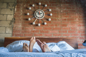 Couple's feet poking out of the perfect sleep environment