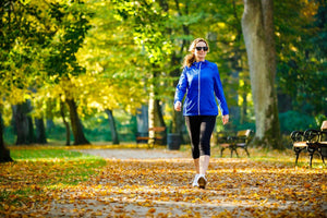 woman walking in a city park in the fall