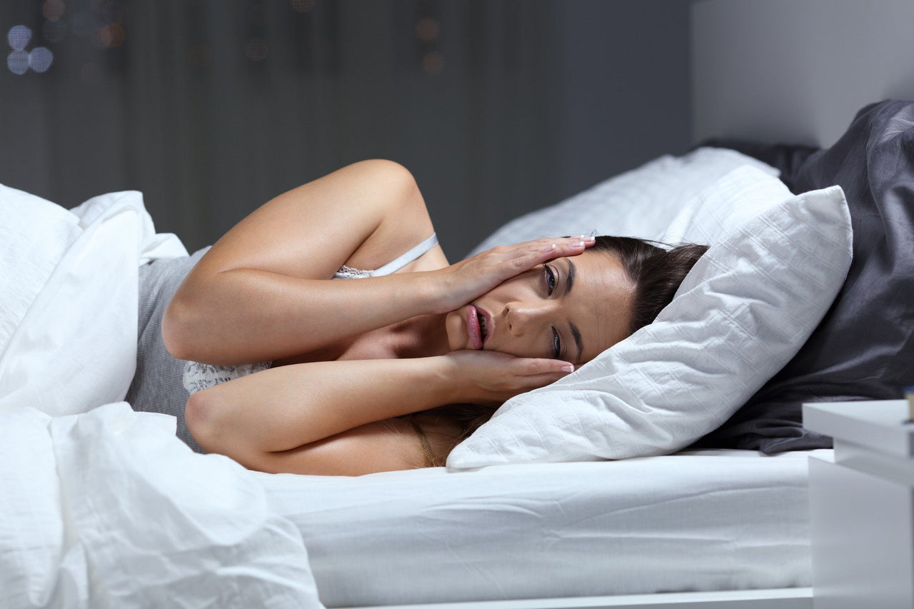 woman with sleep deprivation in bed