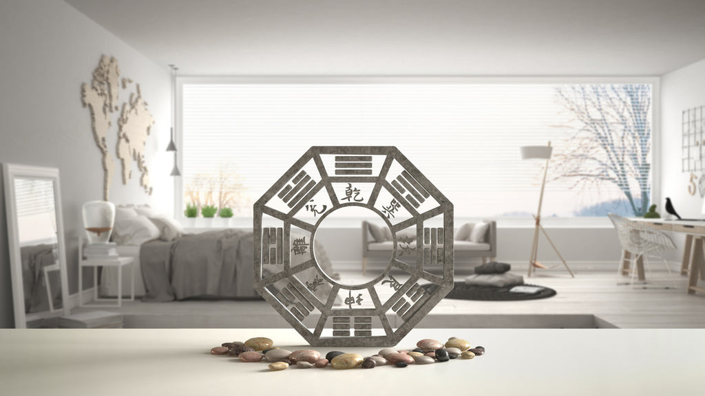 Feng Shui Bagua with pebbles in front of minimalist bedroom