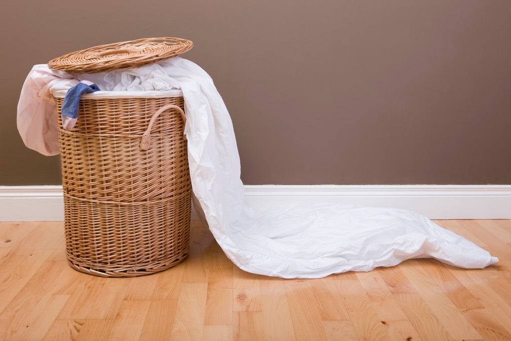 ways to recycle an old bed sheet in the laundry hamper