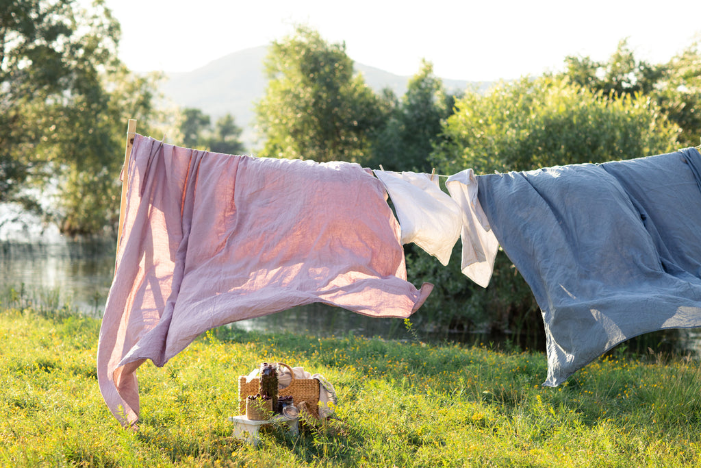 clean organic sheets on clothesline