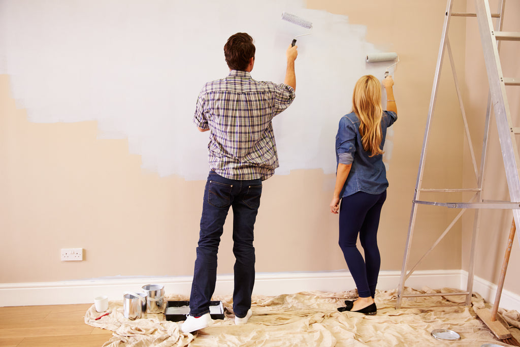 Young couple redecorating with home furnishing trends