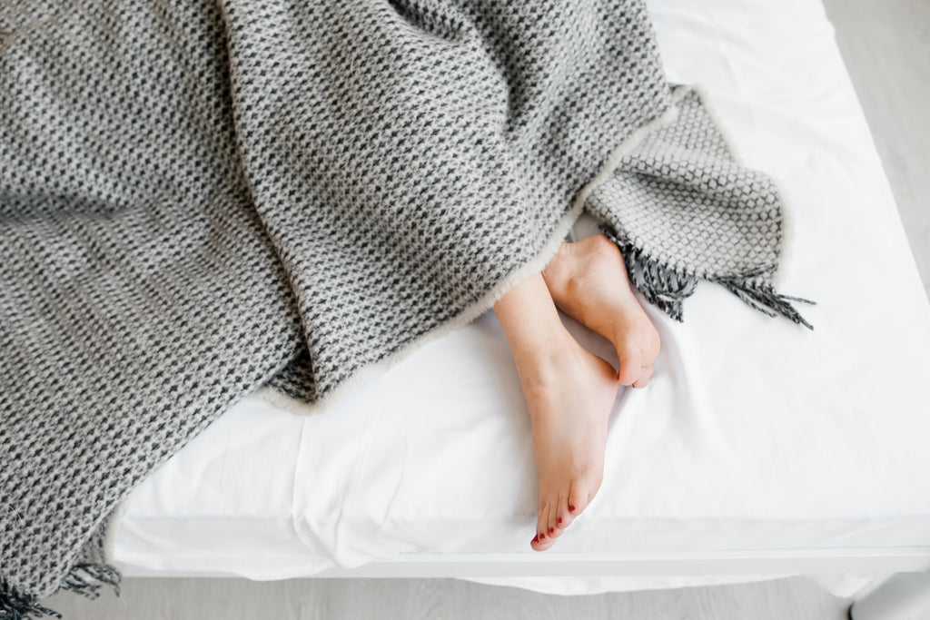 Bare feet and light blankets help you fall asleep when your partner overheats