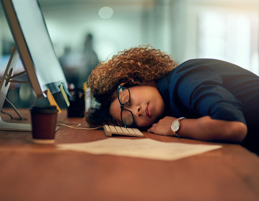 Businesswoman tired at work should fix your sleep schedule