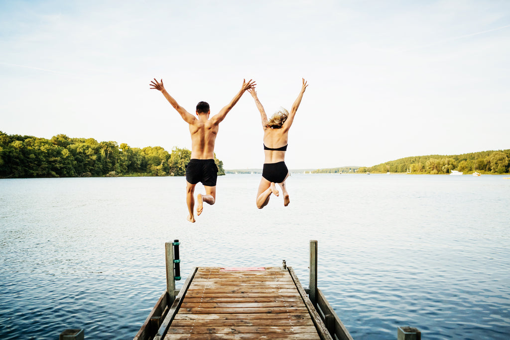 Friends jump into water after a healthy diet and sleep