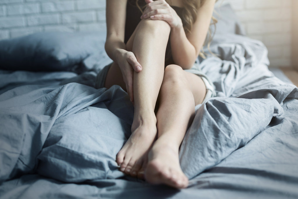 woman with nighttime leg cramps