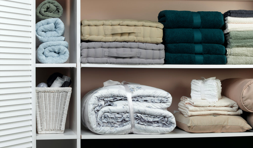 linen closet with extra pillowcases