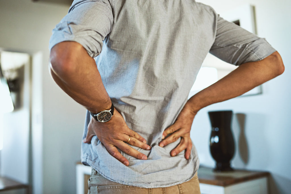 man needs to relieve lower back pain