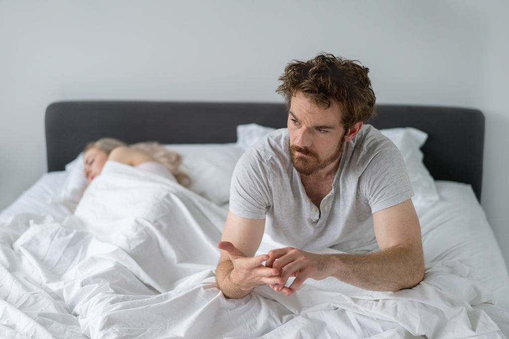 man wondering what to do when you wake up in the middle of the night