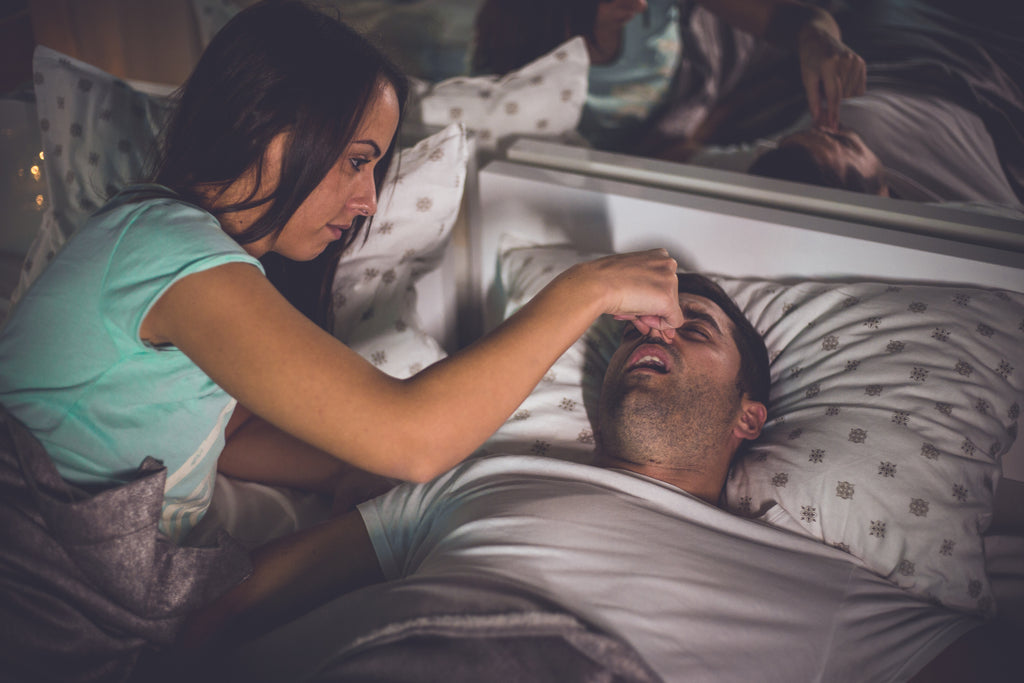 woman can't sleep when her partner snores