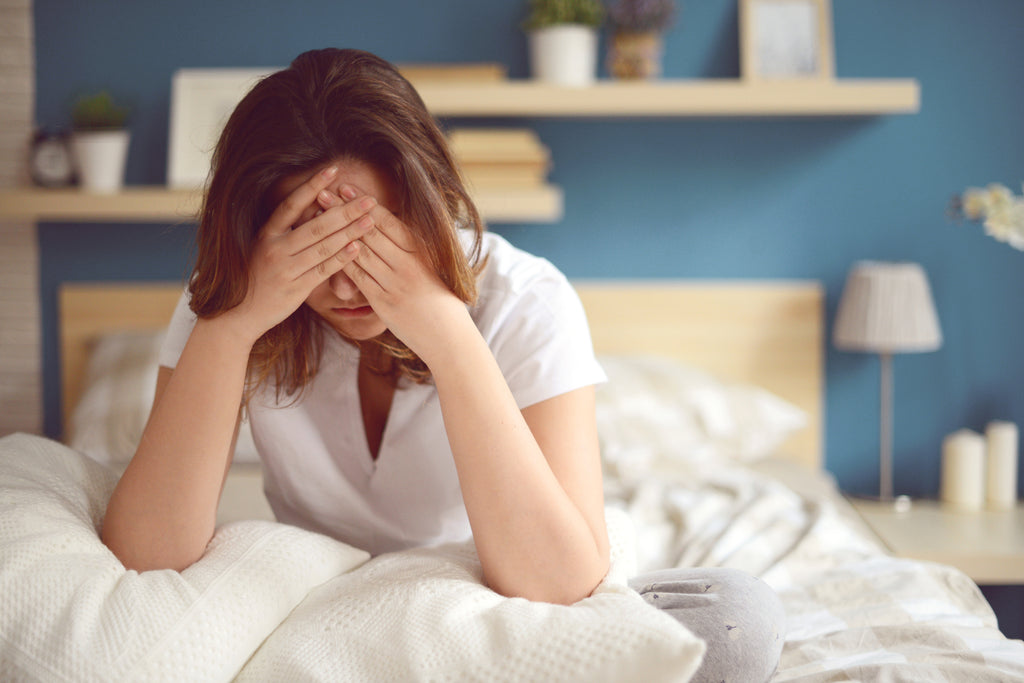 woman in bed needs sleep tips for fibromyalgia