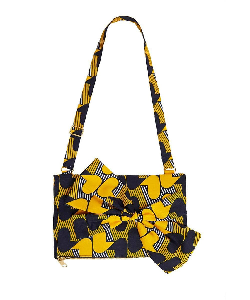 Goldenrod with blue and white print Ankara fabric. Adjustable shoulder stripes.