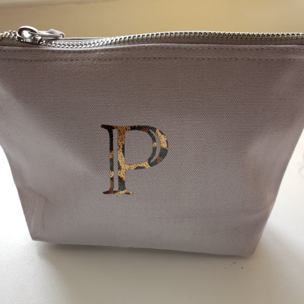 Grey initial pouch with P in leopard print foil. Pouch zipped up and stood up.