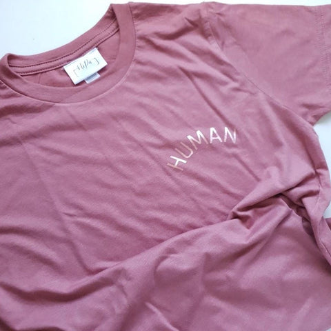 mauve kids unisex tshirt with small rose gold human slogan print