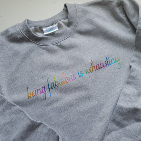 light grey sweatshirt with rainbow foil being fabulous is exhausting slogan print