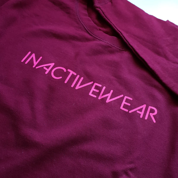 burgundy sweatshirt with glow pink inactivewear slogan