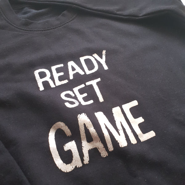 Black sweatshirt with charcoal foil ready set game slogan print
