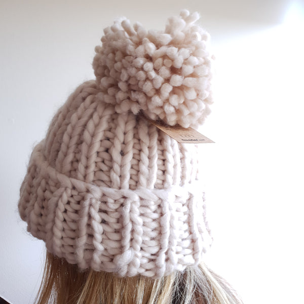 Paula wearing the oversized chunky hand knitted beanie. View from the back.