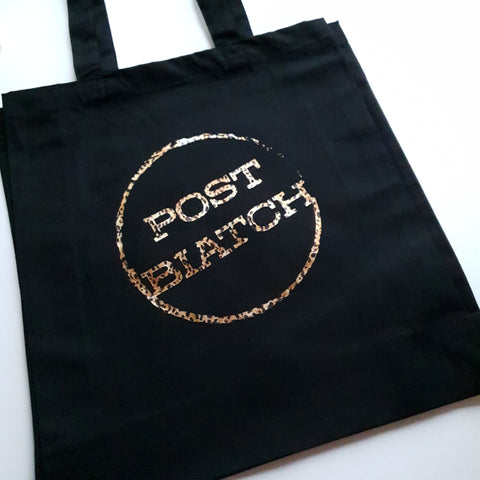 Large black shopper tote bag with post biatch slogan in leopard print