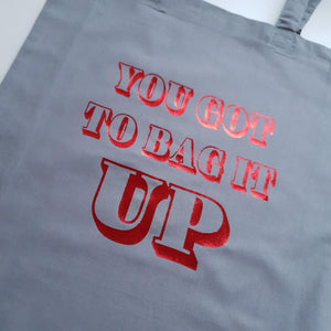 grey tote bag with red foil you got to bag it up slogan